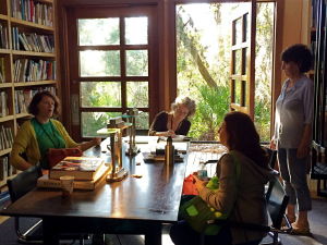 Writers meeting informally in the library at Atlantic Center for the Arts